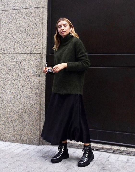 a dark green oversized sweater, a black midi skirt, black hiking boots for an ultimately comfy look