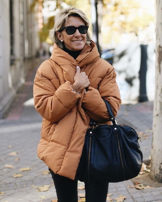 a rust-colored padded jacket is a fresh idea to spruce up a neutral or monochromatic look