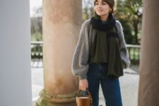 15 a vintage-inspired look with a grey oversized sweater, blue straight jeans, mustard shoes and a matching bucket bag