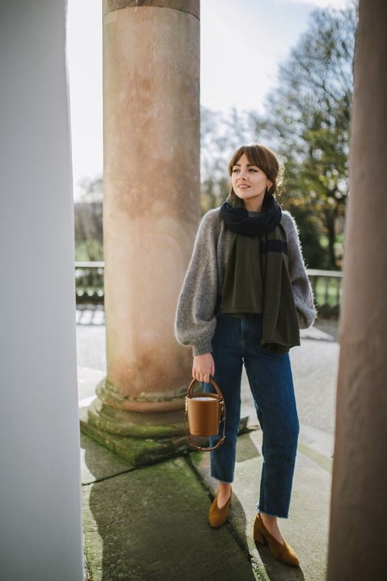 a vintage inspired look with a grey oversized sweater, blue straight jeans, mustard shoes and a matching bucket bag