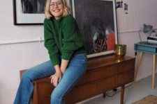 15 cropped blue jeans, a green sweater, red shoes with ankle straps for a bold and chic look