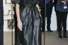 16 Queen Letizia wearing a black leather midi dress with pockets and a belt and nude shoes looks very chic