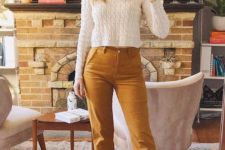 16 a chic look with a white cropped sweater, mustard cropped straight jeans and brown booties