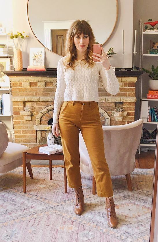 a chic look with a white cropped sweater, mustard cropped straight jeans and brown booties