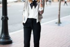 16 a white blouse with a black bow, a silver sequin cropped blazer, black pants and red shoes