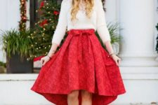 16 a white top with a lace insert, a red floral asymmetrical skirt and metallic shoes for a chic look