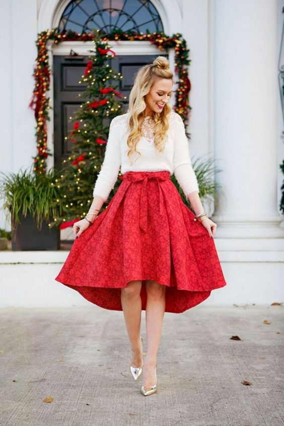 a white top with a lace insert, a red floral asymmetrical skirt and metallic shoes for a chic look