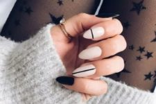 16 white nails with black stripes and black accent nails for a modern and fresh look