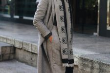 20 a grey and black outfit with a turtleneck, pants, a coat, a printed scarf brings up stylish monochrome