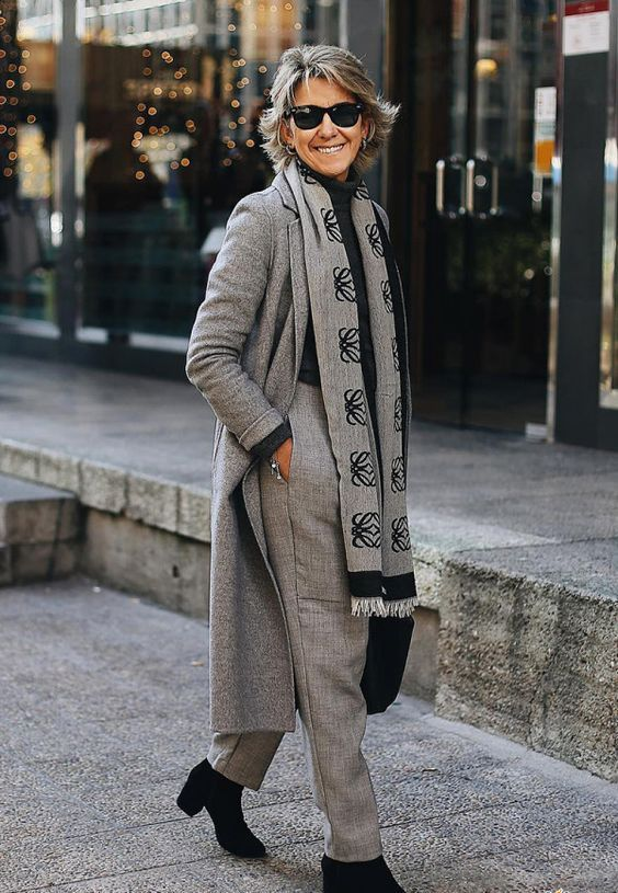 a grey and black outfit with a turtleneck, pants, a coat, a printed scarf brings up stylish monochrome