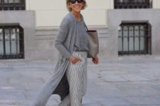22 a fresh and lightweight monochromatic outfit with a tee, a cardigan, striped pants, white sneakers and a grey bag