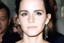 Emma Watson rocking a mono earring with two pearls is a feminine idea