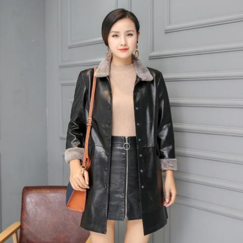 With beige shirt, two colored bag and black leather skirt
