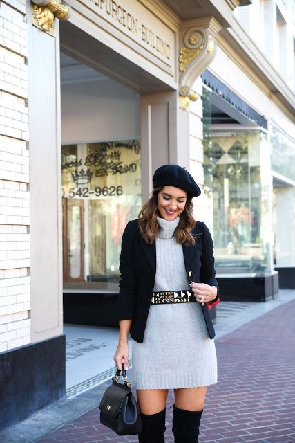 With beret, black jacket, black over the knee boots and leather bag