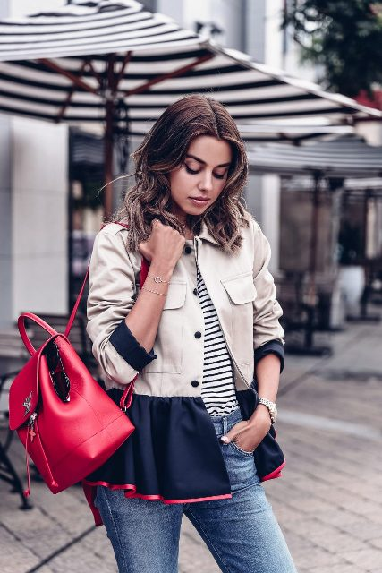 With black and white striped shirt, red leather backpack and jeans