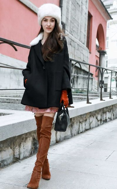 With black coat, printed mini dress, black bag and brown suede over the knee boots