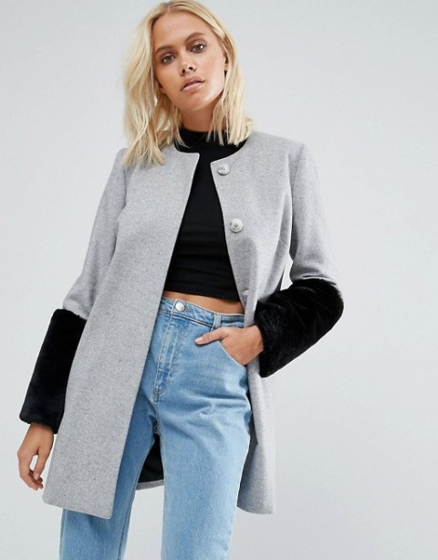 With black cropped shirt and jeans