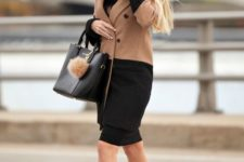 With black dress, tote bag and pumps