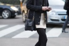 With black fur collar jacket, black bag and high heeled boots