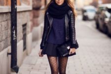 With black leather jacket, black scarf, sweater, mini skirt and black leather ankle boots