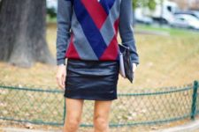 With black leather mini skirt, clutch and ankle strap shoes
