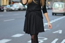 With black mini dress and black suede ankle boots