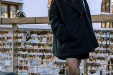 With black mini dress, fur collar coat and white sneakers