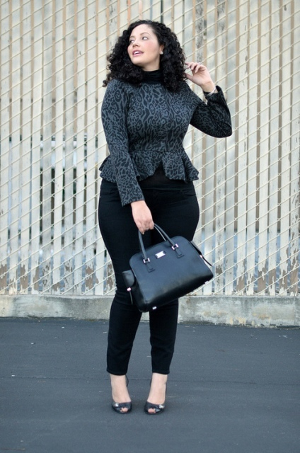 With black pants, black bag and cutout shoes