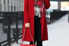 With black pants, plaid scarf, high heeled boots and red coat