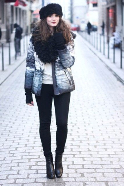 With black pants, white t-shirt, printed puffer jacket and black high heeled boots