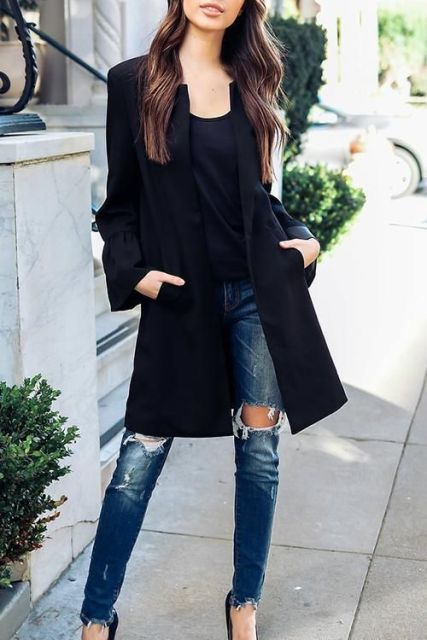 With black shirt, distressed jeans and black pumps