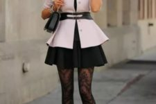 With black skirt, small bag, platform shoes and printed tights