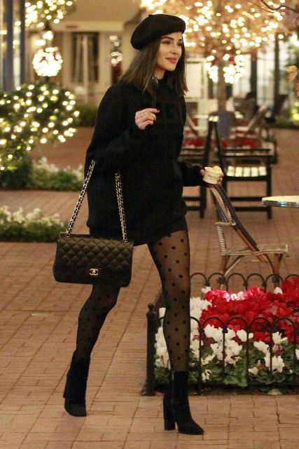 With black sweater dress, black beret, chain strap bag and black boots