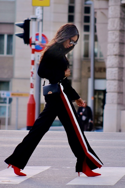 With black sweater, red low heeled boots and mini bag