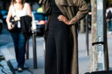 With black top, black culottes and gray boots