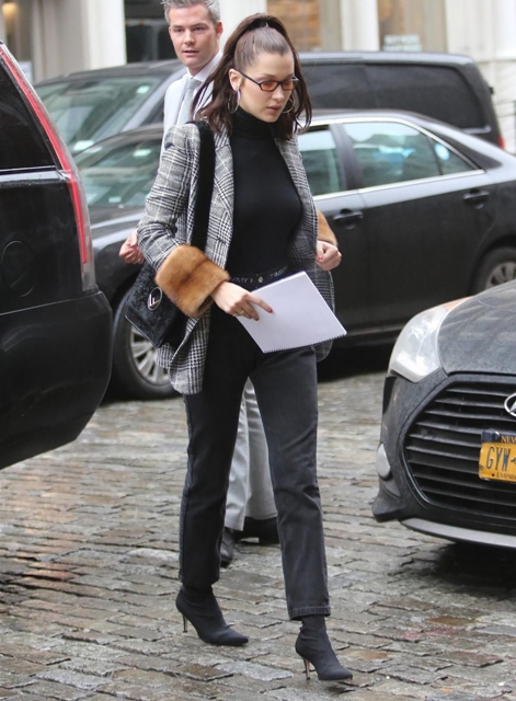 With black turtleneck, black bag, straight pants and high heeled boots