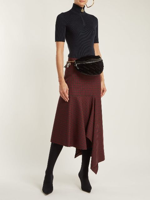 With black turtleneck, printed midi skirt and black boots