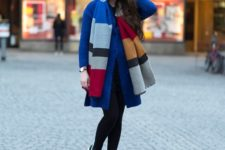 With blue coat, black leggings and sneakers