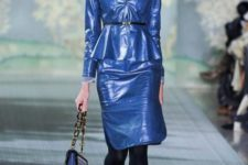 With blue patent leather skirt, black shoes and chain strap bag
