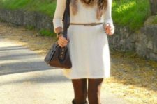 With brown high boots, leopard scarf and bag