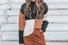 With brown suede mini skirt, leather bag and sunglasses