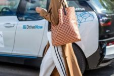 With brown trench coat, printed tote bag and white sneakers