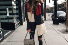 With distressed jeans, white flat shoes, printed bag and sweater