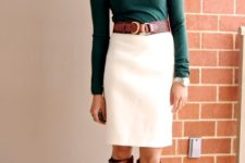 With emerald turtleneck, brown belt and brown leather boots