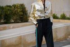 With golden metallic bomber jacket and white boots