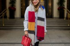 With gray coat, red high boots and red small bag