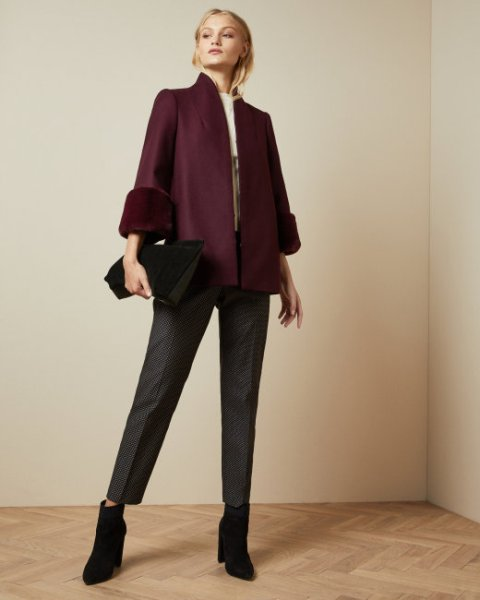 With gray cropped trousers, black ankle boots, black clutch and beige shirt