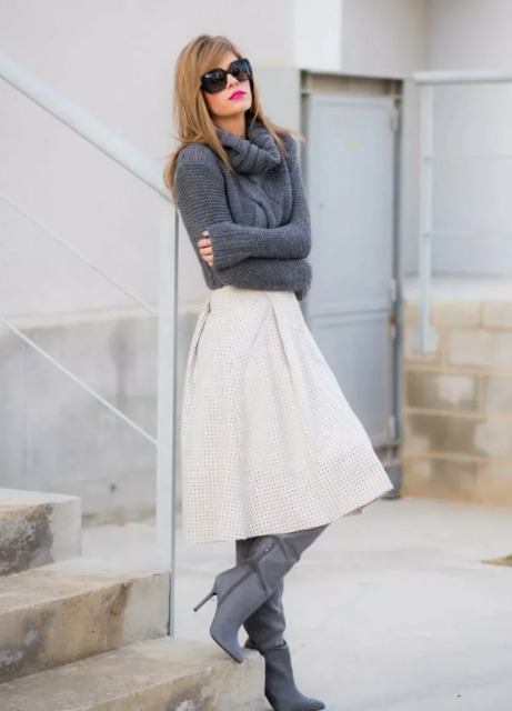 With gray turtleneck sweater and gray high boots