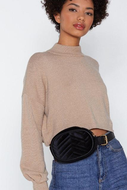 With high-waisted jeans and beige loose cropped sweatshirt