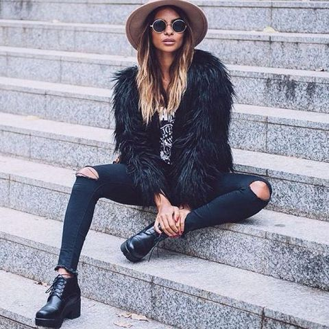 With labeled t-shirt, wide brim hat, distressed jeans and black lace up boots